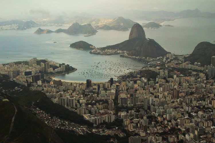 Aerial view of cityscape by sugarloaf mountain at guanabara bay
