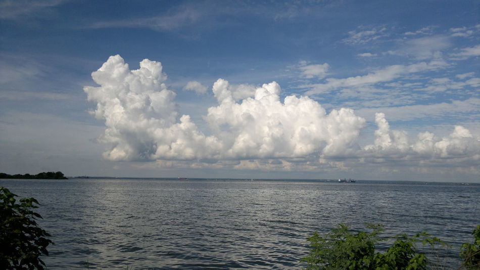 Clouds over the lake. Beauty In Nature Cloud - Sky Day Horizon Over Water Lago De Maracaibo Nature No People Outdoors Rippled Scenics Sea Sky Tranquil Scene Tranquility Tree Water
