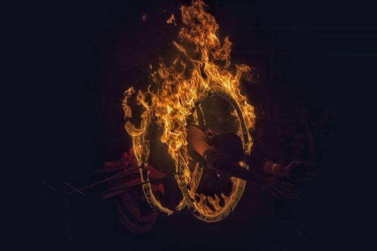 Man burning at night