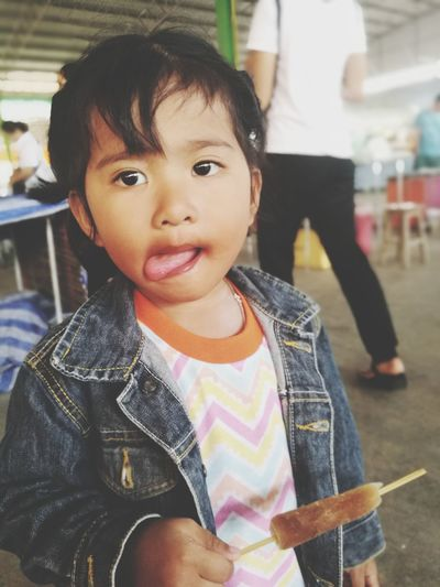 Portrait of cute baby girl holding flavored ice