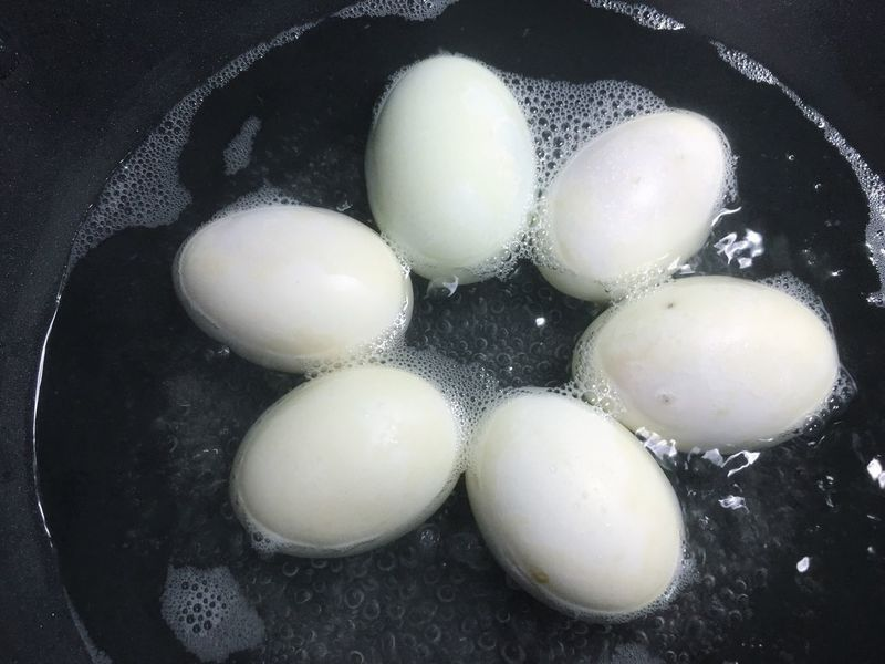 Egg Food And Drink Healthy Eating Food Preparation  Freshness Frying Pan Indoors  High Angle View Close-up Egg Yolk No People Fragility Egg Carton Day Salted Eggs Food Preservation