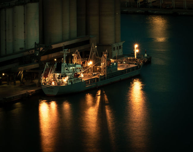 Nautical Vessel Water Transportation Illuminated Reflection Mode Of Transportation Waterfront Night No People Ship Sea Industry Harbor Architecture Nature Freight Transportation Shipping  Outdoors Business Bateau Insdustry Industrial Equipment Industrial Photography Import Export Commerce