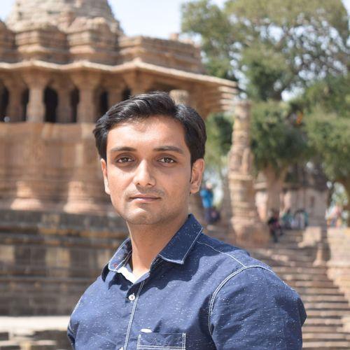 Portrait of man against historic building