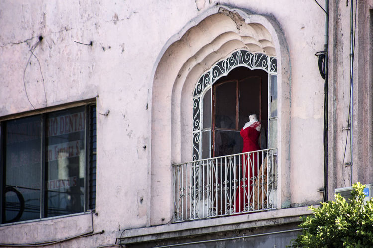 Mannequin at balcony of building
