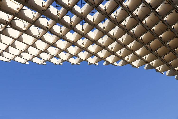 Abstract architecture Blue Sky Clear Sky Low Angle View No People Day Pattern Nature Copy Space Lighting Equipment Architecture Metal White Color Sunlight Outdoors Built Structure Repetition Roof Geometric Shape Ceiling Directly Below Parasol Setas