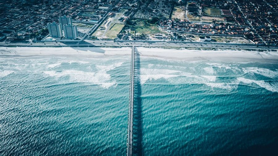 City and ocean Beachphotography DJI Mavic Pro Dronephotography Wallpaper Beach EyeEm Selects Water Nature Day No People Beauty In Nature Blue High Angle View Scenics - Nature Sea Outdoors Mode Of Transportation Tree Travel Land Tranquility Sunlight