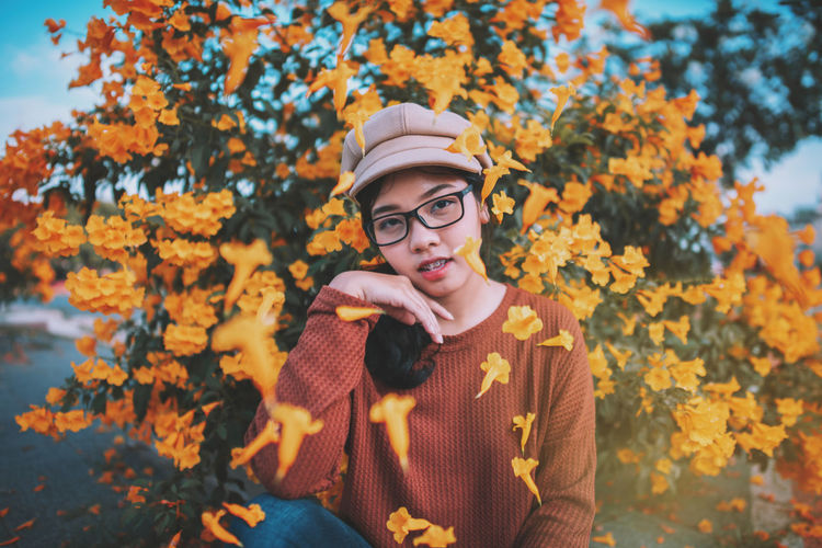 There are always flowers for those who want to see them. 🌸🌼 Autumn Front View Plant One Person Change Young Adult Leisure Activity Real People Lifestyles Portrait Tree Nature Young Women Casual Clothing Glasses Day Eyeglasses  Headshot Focus On Foreground Outdoors Leaves Autumn Collection Teenager Celebration Autumn