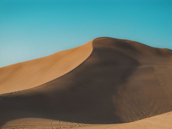 Sand Dune Desert Landscape Sky Climate Land Clear Sky Non-urban Scene Nature Outdoors Remote Atmospheric Day Sand Blue No People Arid Climate Desert Beauty Yellow Smooth