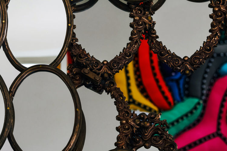 No People Close-up Pattern Design Art And Craft Metal Focus On Foreground Creativity Day Craft Shape Hanging Indoors  Jewelry Representation For Sale Decoration Low Angle View Selective Focus Personal Accessory Mirror Pill Colors