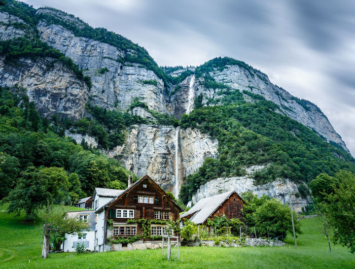Architecture Beauty In Nature Building Building Exterior Built Structure Chalet Cloud - Sky Cottage Day Grass House Land Landscape Mountain Mountain Range Nature No People Non-urban Scene Outdoors Plant Residential District Scenics - Nature Seerenbachfälle Sky Waterfall