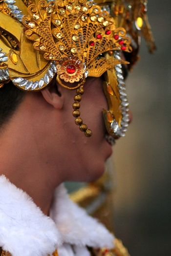 Side View Of Young Man Wearing Headdress While Standing Outdoors