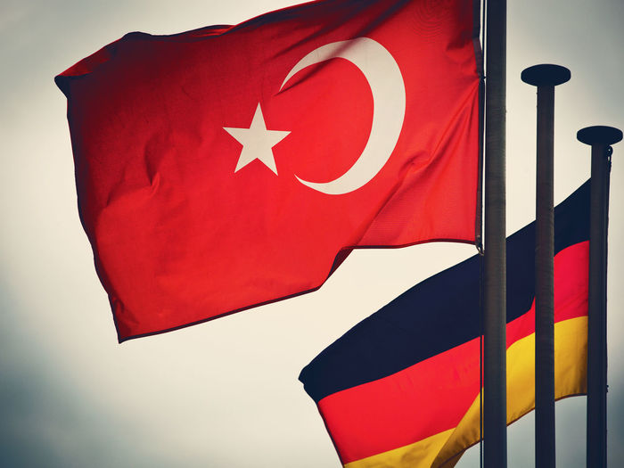 German Flag Relationship Turkey Turkey Flag Close-up Day Emotion Flag Focus On Foreground Germany Independence Low Angle View National Icon Nations Flags No People Patriotism Pride Red Shape Sky Star Shape Textile Waving White Color Wind