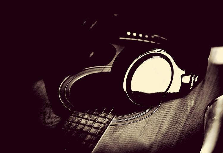 Guitar and headphone in vintage style