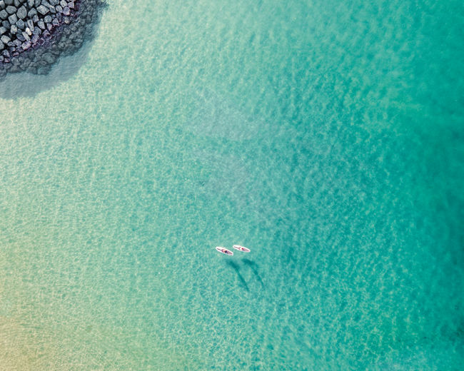 High angle view of swimming in sea