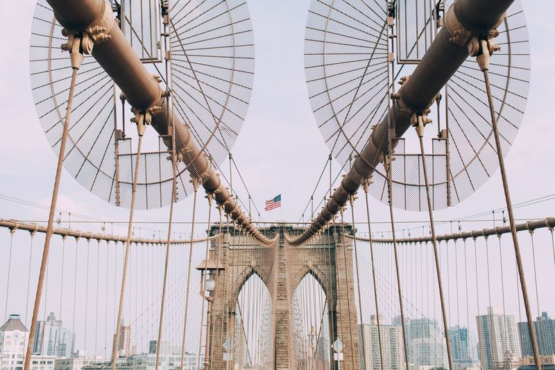 Brooklyn Bridge In City Against Sky