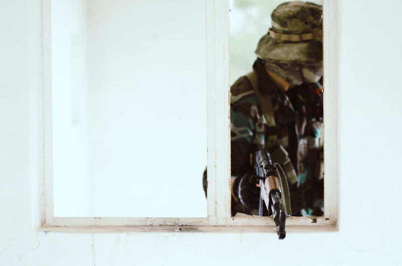 Special forces soldier holding rifle gun aim window white frame cover Window Entrance Day Door No People Safety Outdoors Architecture Security Lock Mammal One Animal Protection Built Structure Transparent Airsoft Sniper Trooper Soldier Army Army Soldier Special Forces Aim Aiming Camouflage Clothing Camouflage Hat AK 47 Gun