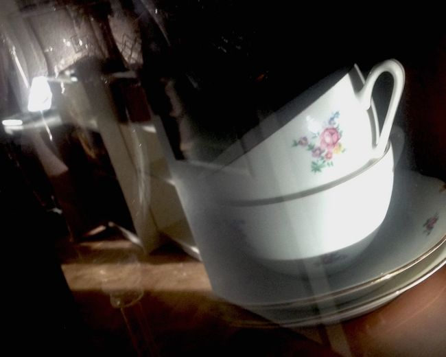 Behind Glassdoors Cupboard On The Shelf My Cupboard Life No People Close-up Cup Sun Light Reflection_collection Reflections Still Life Lighted Ilumination Sun Reflection Iluminated Tea Cups Spirit Of Past