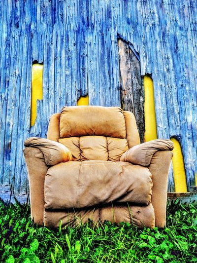 Old chair against blue wall