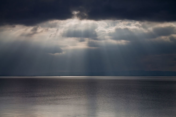 Awe Backgrounds Beams Of Light Beauty In Nature Cloud - Sky Day Dramatic Sky Horizon Horizon Over Water Nature No People Outdoors Scenics Sea Sky Spirituality Storm Storm Cloud Sun Beam From Cloud Sun Beams Thunderstorm Tranquil Scene Water Weather
