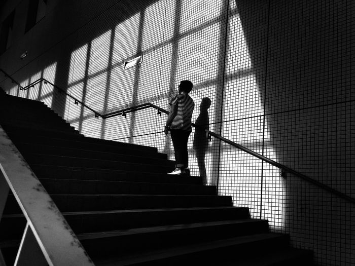 Low Angle View Of Woman Standing On Staircase At Tokyo Big Sight
