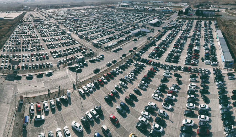 High Angle View Architecture Building Exterior Built Structure City Aerial View Transportation Day Street Mode Of Transportation Motor Vehicle Car Cityscape In A Row Land Vehicle Road Parking Lot Crowd Outdoors Traffic