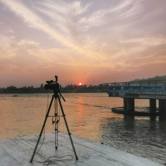 Camera - Photographic Equipment Tripod Cloud - Sky Sunset Photography Themes Water Travelingtheworld  India See The World Through My Eyes River Rishikesh Sunset And Clouds  Sunsetlover Sunset_collection Riverside View Travelphotography No People