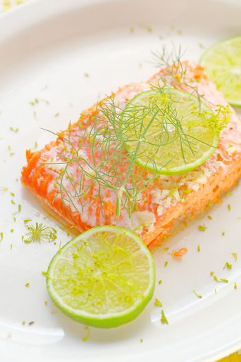 Salmon with lime and dill Copy Space Home Cooking Homemade Food Natural Light Citrus Fruit Close-up Dil Food Fresh Herbs  Freshness Garnish Healthy Eating Indoors  Lime No People Omega 3 Overhead Plate Ready-to-eat Room For Text Salmon Seafood Serving Size