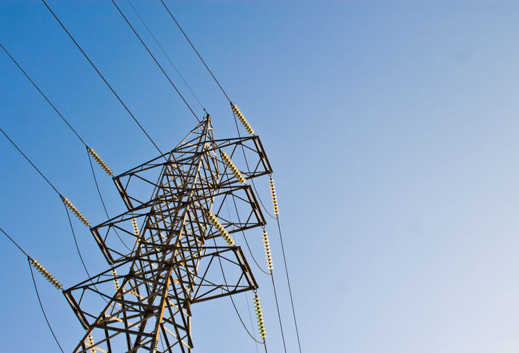High Section Of Electricity Pylon Against Blue Sky