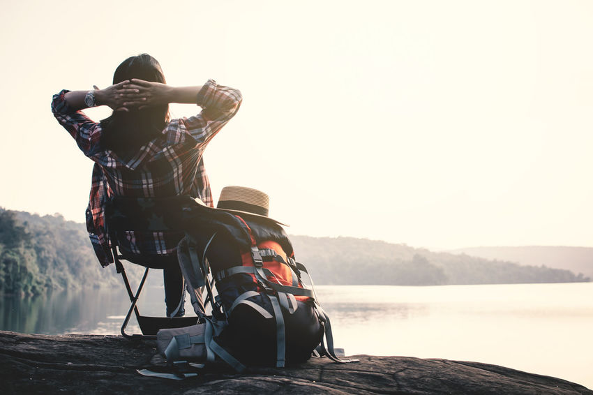 Holiday Relaxing Travel Backpack Lifestyles Mountain Nature One Person Sitting Sky Water