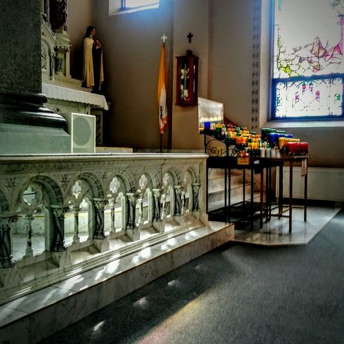 Indoors  Illuminated Day No People Spirituality EyeEm Gallery Irwin Collection Praying For World Peace EyeEm Best Shots Church Interior Place Of Worship Architecture Arch Candles Burning Cathedral Window Beautiful ♥ Illuminating Irwin Collection EyeEm