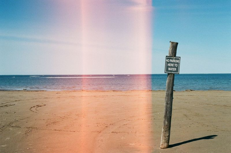 35mm 35mm Film Analogue Photography Beach Beauty In Nature Blue Cloud Film Is Not Dead Film Photography Horizon Over Water Light Leak Nature Outdoors Pole Sand Scenics Sea Shore Sky Sunbeam Sunlight Sunny Tranquil Scene Tranquility Water
