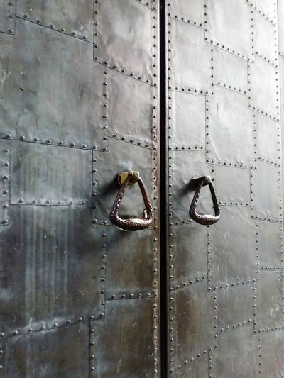 iron door gate Iron Steel Old Ancient Dark Closed Entrance Exit Backgrounds Full Frame Metal Close-up Brushed Metal Locked Sheet Metal Lock Corrugated Iron Door Knocker Keyhole Closed Door