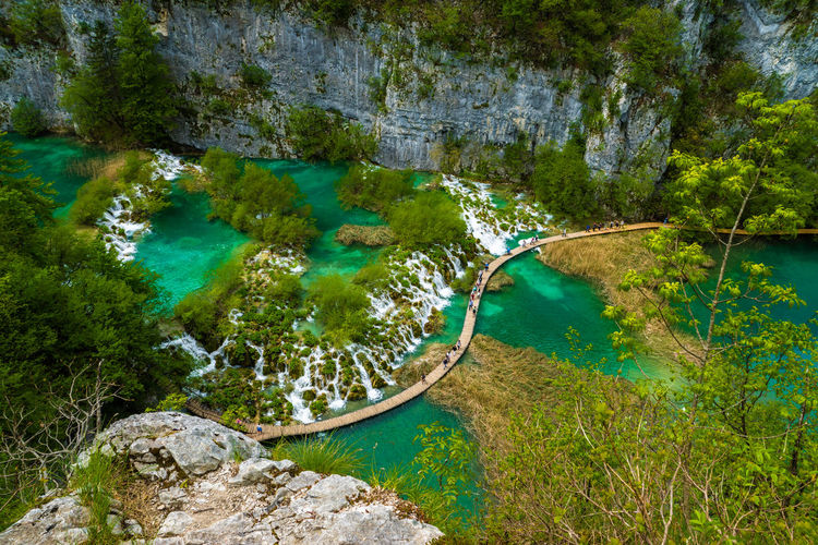 High angle view of boardwalk by waterfalls at plitvice lakes national park