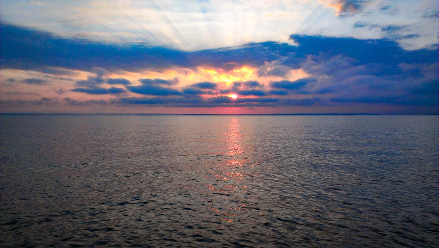 Sunrise over Lake Livingston, Texas. Tranquility Outdoors Non-urban Scene No People Nature Love Water Tranquil Scene Lake Sunrise Sunrise Over Water Sunrise Over Lake Serenity Scenics Beauty In Nature Clouds Sunbeams Infinity