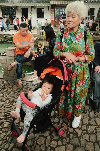 Children on the tour NO.3 Children Grandma And Granddaughter Childhood Full Length Child Sitting People Looking Down Cute Children Only Togetherness Outdoors Standing Boys Two People Adult Girls Day Tourism