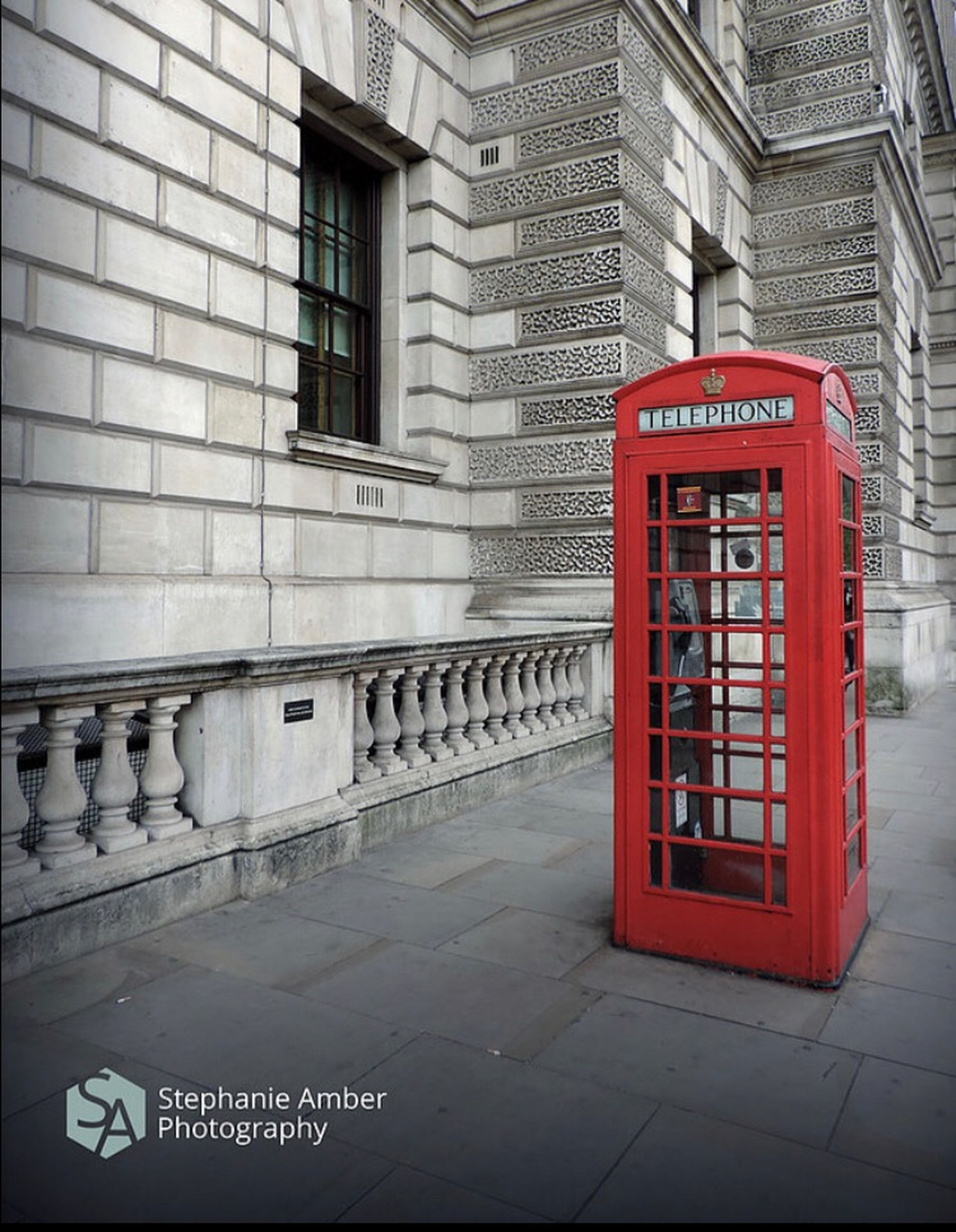 communication, telephone, telephone booth, architecture, built structure, text, building exterior, western script, red, technology, city, connection, day, pay phone, sidewalk, street, no people, footpath, outdoors, transportation