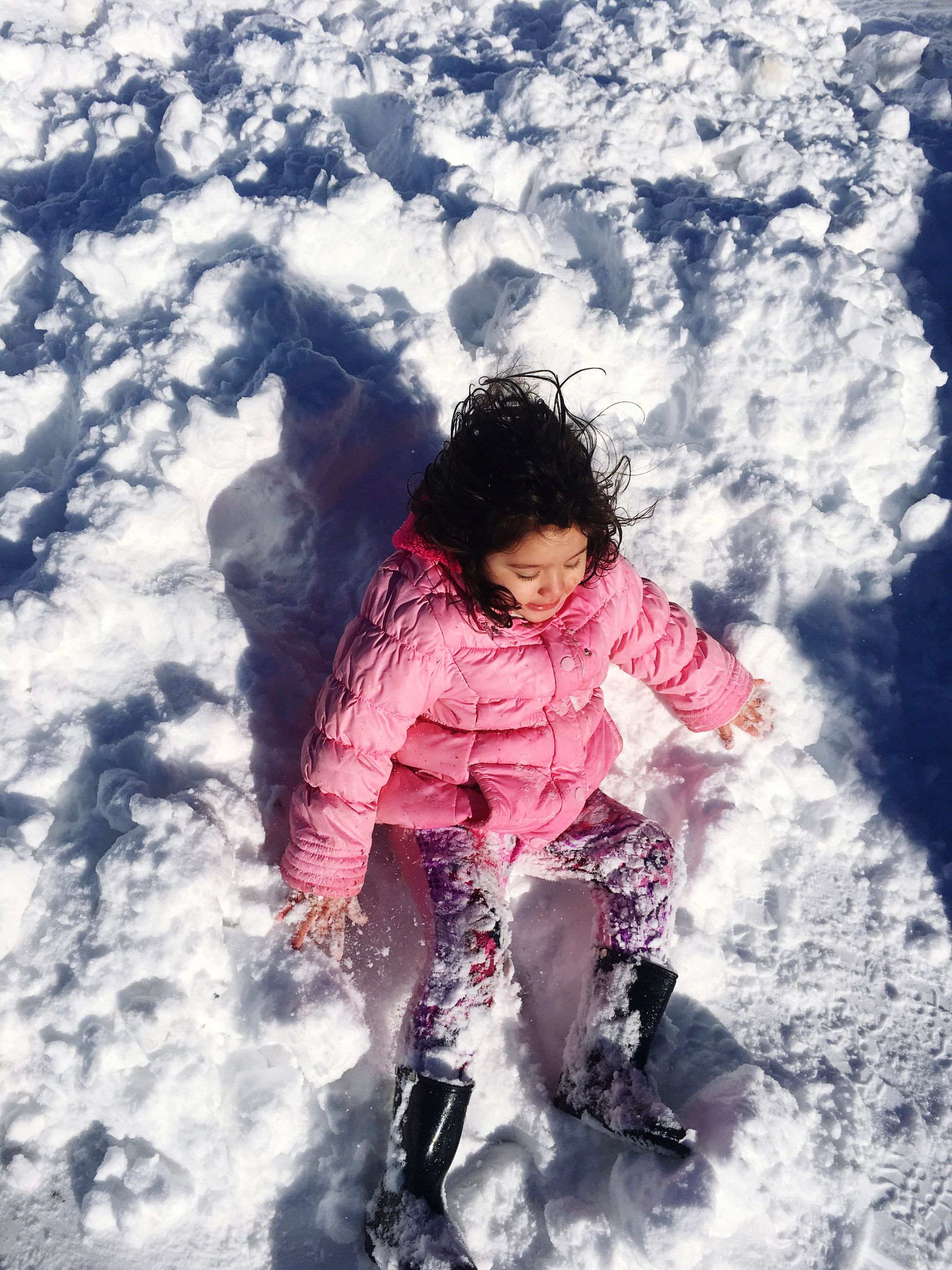 childhood, children only, child, one person, full length, innocence, high angle view, outdoors, looking down, real people, one girl only, people, warm clothing, leisure activity, day, snow, cold temperature, nature