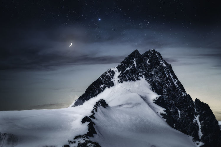 Großglockner at night Astronomy Beauty In Nature Cloud - Sky Cold Temperature Galaxy Moon Mountain Nature Night No People Outdoors Scenics Sky Snow Space Star - Space Tranquil Scene Tranquility Weather Winter EyeEm EyeEm Best Shots