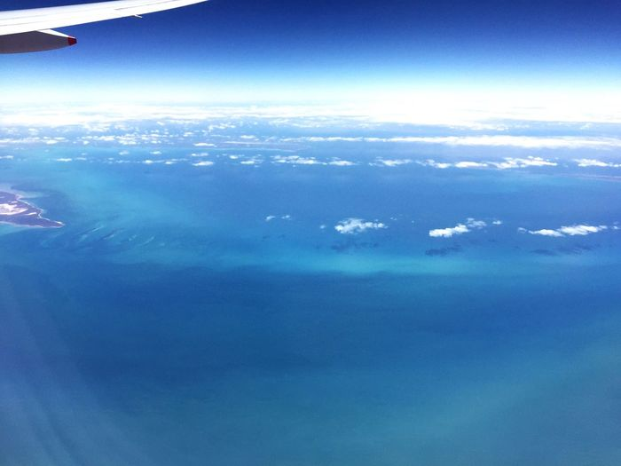 Flying High Blue Sky And Blue Sea Bluesky No People Aerial View Airplane