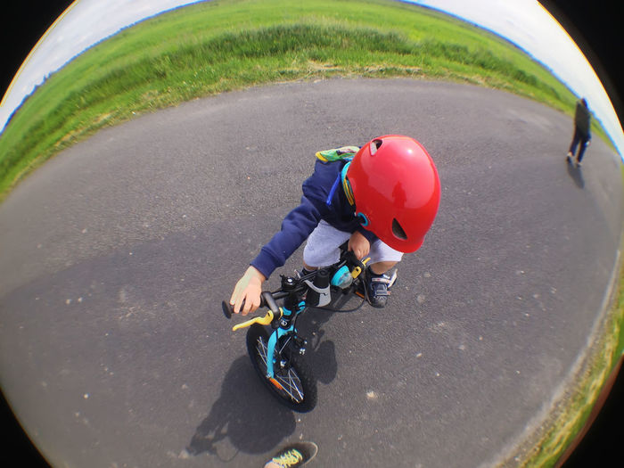 Low ride Boys Childhood Cycling Helmet Fish-eye Lens Helmet High Angle View Leisure Activity Lifestyles One Person Outdoors Playing Live For The Story