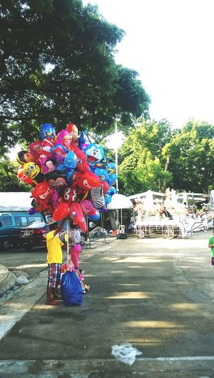 After joining a fan run, decided to stroll in the park and saw this balloon vendor. Park Streetphotography Balloons Lumia Quezoncity Manila Philippines