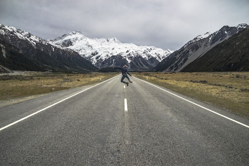 Aoraki Mount Cook National Park New Zealand Mountain Road The Way Forward Beauty In Nature One Person Full Length An Eye For Travel Real People Scenics Transportation Landscape Mountain Range Snow Tranquil Scene Adventure Lifestyles Nature
