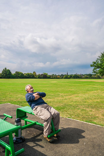 Middle aged man having fun in the outdoor gym Activity Activity1 Exercise Exercising Grass Guitar Gym Gymnasium Livestyle Mammal Man Outdoors Outside Park Person Playground The Great Outdoors - 2017 EyeEm Awards
