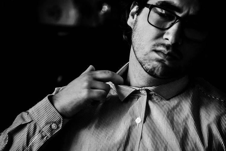 Man trying to loosen collar