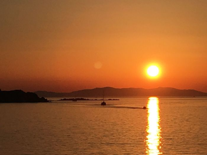 Sunset Sun Sea Beauty In Nature Nature Scenics Orange Color Water Tranquil Scene Tranquility Mountain Outdoors Waterfront Sunlight Sky Silhouette No People Mykonos,Greece