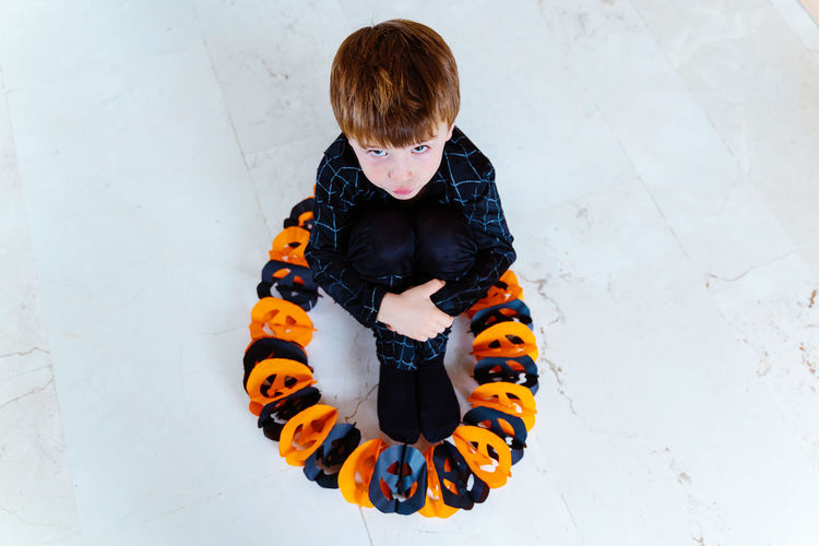 High angle view of boy looking away