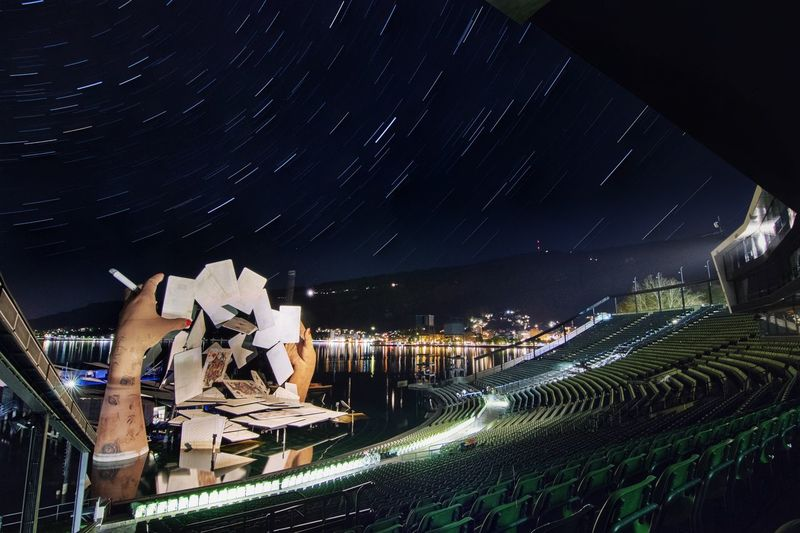 Opera Floating Stage under Trails of Stars Nightscape Nightphotography Astrophotography Operahouse EyeEm Gallery EyeEm Best Shots EyeEmBestPics Eye4photography  EyeEmNewHere EyeEm Selects Startrail  Night Architecture Illuminated Built Structure Building Exterior City Sky Star - Space Nature Building No People Star Outdoors Space Astronomy Glowing Star Field