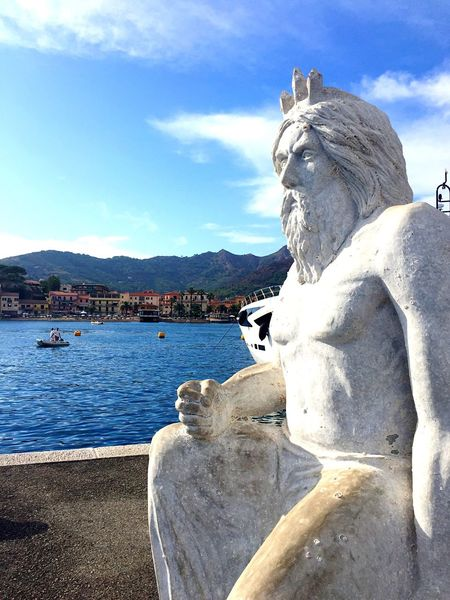 Statue Sculpture Human Representation Art And Craft Sky Cloud - Sky Male Likeness Day Outdoors No People Water Travel Destinations Mountain Nature Isola D'Elba  Porto Azzurro Italy