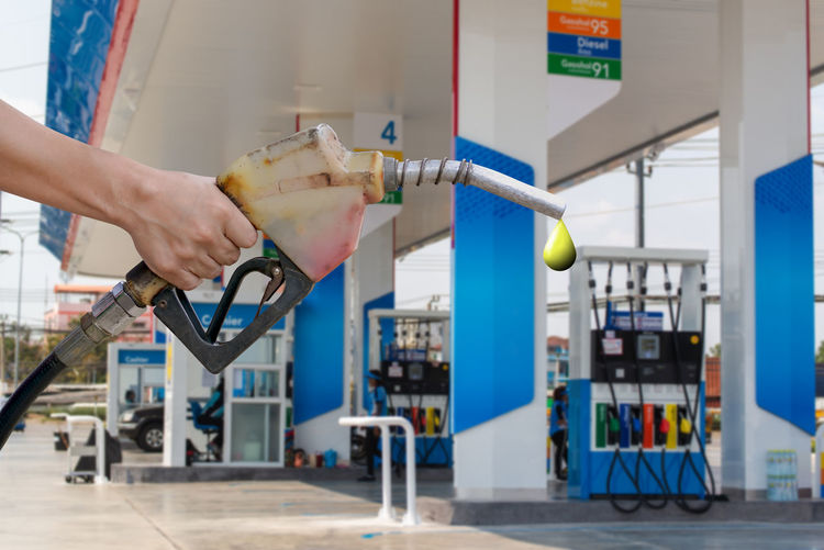 Human Hand One Person Human Body Part Hand Holding Real People Machinery Focus On Foreground Fuel And Power Generation Technology Body Part Industry Indoors  Business Architecture Men Filling Lifestyles Close-up Human Limb Petroleum Petrol Station Fuel Add Gas Station