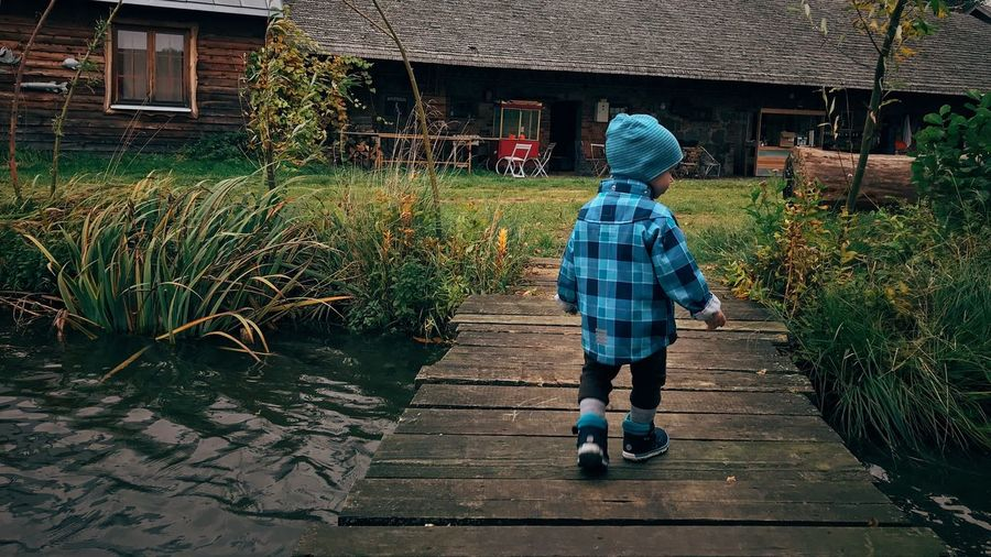 EyeEm Selects Childhood Real People Child Full Length Built Structure One Person Nature Leisure Activity Rear View Day Outdoors Warm Clothing